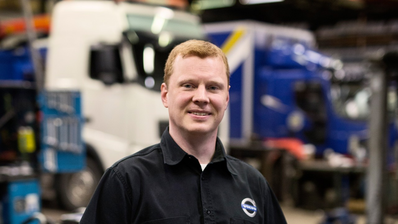 Volvo trucks services servicing planning man black shirt